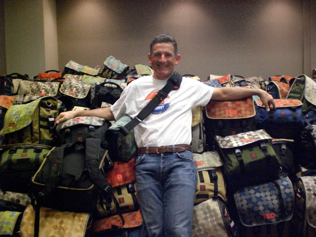 Spy photo of Mark Dwight, Rickshaw founder and bag designer, with some of the TED 2009 gift bags